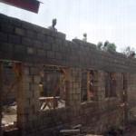 Laying the last layer of bricks
